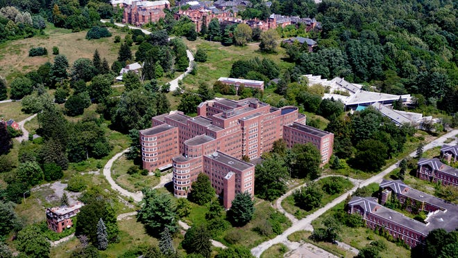 This aerial view looking northeast shows a portion of the former Hudson River Psychiatric Center in the Town of Poughkeepsie, a 156-acre parcel that is a developer has bought with plans for demolition of this and most other buildings before redevelopment.