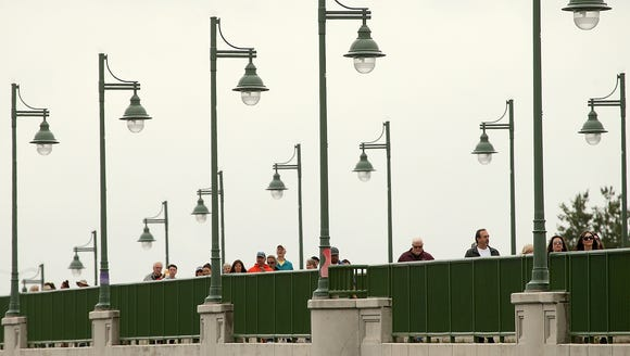 Bridging Bremerton Story Walk participants cross the