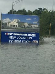 A sign for a new First Financial Bank is swamped by flood waters.