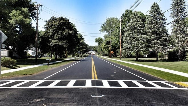 The town of Perinton finishes its sidewalk and sewer project on Mason Road.