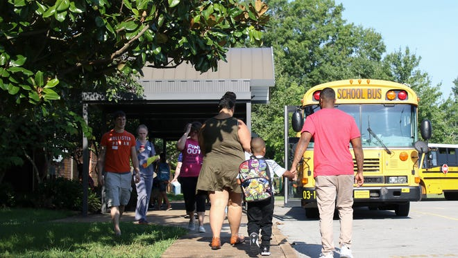 Students arrive at Barksdale Elementary School for the first day of school on Monday.