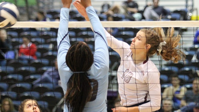 Meredyth Howard (18) is expected to fill a major offensive void near the net for the St. Thomas More volleyball squad this fall.