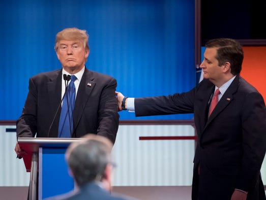 Sen. Ted Cruz, right, approaches Donald Trump after