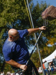 Chad Thompson, of Albuquerque, competes in the sheaf toss Saturday at the Aztec Highland Games and Celtic Music Festival at Riverside Park in Aztec.