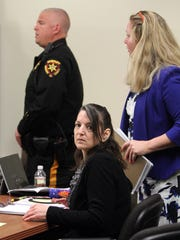 Michelle Lodzinski is shown in State Superior Court in New Brunswick during her murder trial Thursday, April 14, 2016.  Lodzinski, 48, a former South Amboy resident, has been accused of killing her son Timothy, 5, more than 20 years ago.