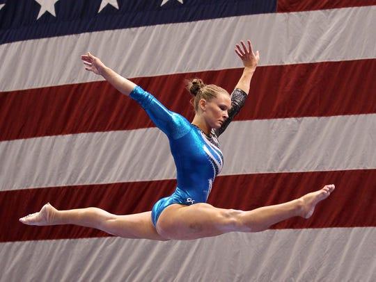 Bridget Sloan (USA) competes on the balance beam during
