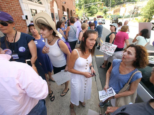Tammy Snyder Murphy, c, wife of NJ Gubernatorial candidate Phil Murphy, speaks with Cynthia Verrone of Montville as she attended the weekly 'Fridays with Frelinghuysen' rally outside Congressman Frelinghuysen's office in Morristown. July 21, 2017. Hanover, NJ