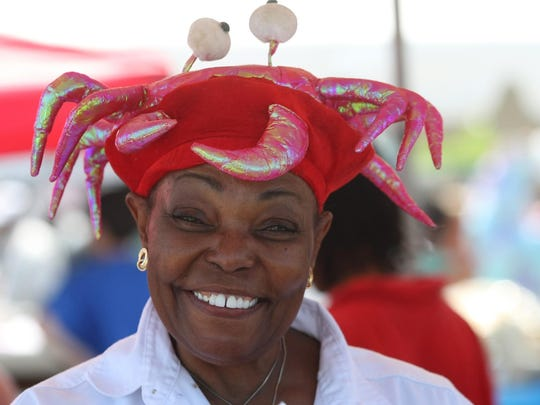 Rita Simmons of Simply Southern Cuisine  serves up a smile at last year's New Jersey Seafood Festival.