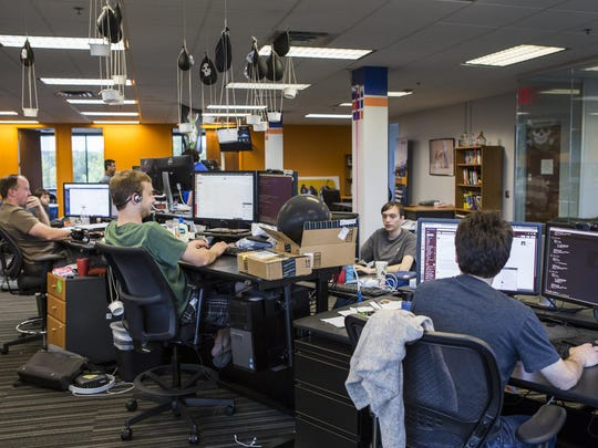 Employees in SevOne's software development department work at the company's Pike Creek office on Monday afternoon.