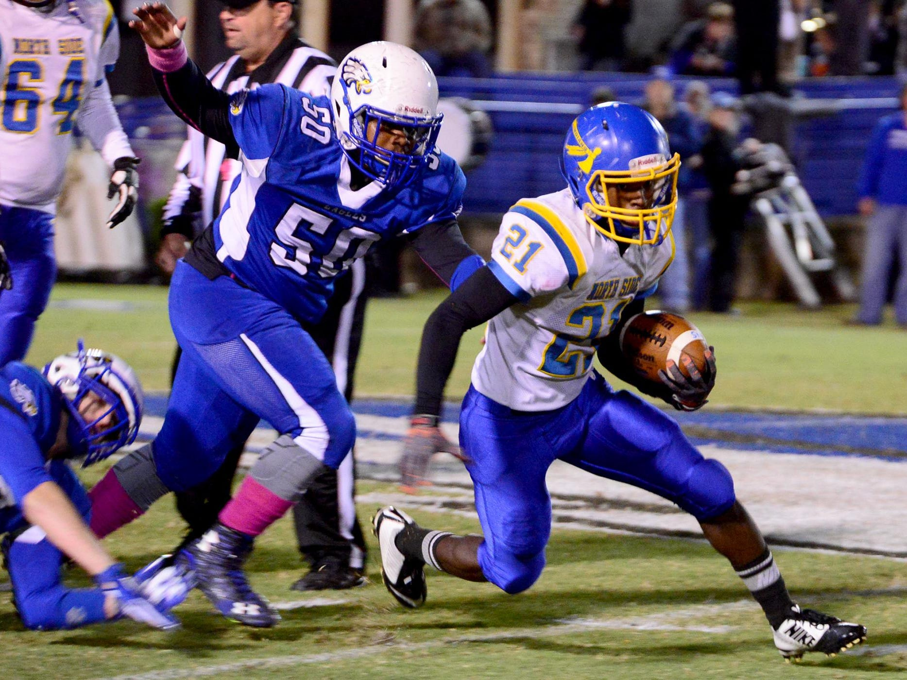 North Side's Darius Brown is chased by Chester County's Eric Arnold during their game Friday evening.