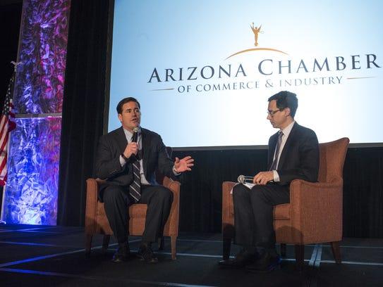 Gov. Doug Ducey (left) answers questions for Glenn