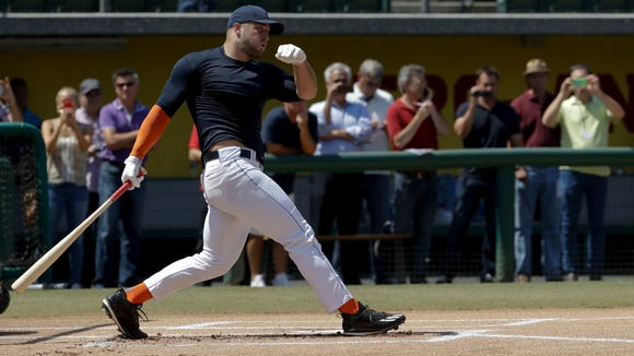 Former NFL quarterback Tim Tebow hits for baseball scouts and the media during a showcase on the campus of the University of Southern California on Tuesday.