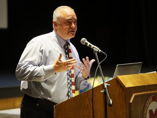 Madison Superintendent Dr. Michael Rossi introduces the thirty-four Madison school district staffers (teachers, administrators and other employees) with more than 20 years in the district are honored at Madison High School on their first day back at school. September 1, 2016, Madison, NJ
