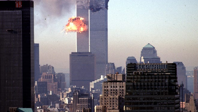A hijacked commercial plane crashes into the World Trade Center 11 September 2001 in New York.