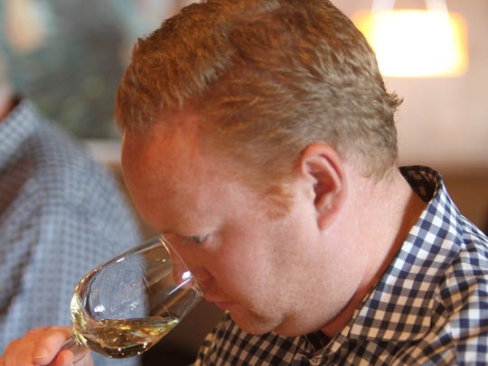 Michael West, with The Ritz-Carlton, Dove Mountain, sniffs a white wine at The Arizona Republic Wine Competition at Tarbell's in Phoenix,  Arizona on October 26, 2015. (Photo by Ben Margiott/The Republic)