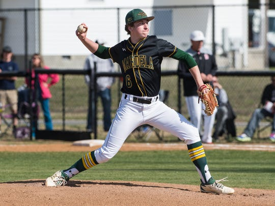 Mardela's Ethan Peterman (6) throws a pitch during