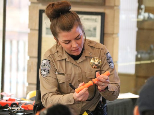 Sarah Genzman, a watercraft officer with ODNR, shows a pair of handheld ice picks that can easily be worn and kept at the ready.