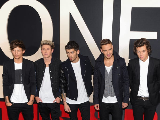 """One Direction is easily the most famous boy band alive. The five young lads from England have risen to become pop music's reigning princes, with an arsenal of hit songs and a slew of screaming fans at their back. Here they arrive at the premiere of their pop documentary """"One Direction: This Is Us,"""" in theaters Aug. 30. USA TODAY's Yohana Desta takes a look at the rise of the band, from reality show rejects to platinum-selling musical act."""