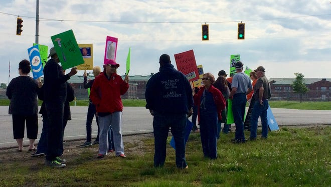 Picketers gathered across the street from Chillicothe Correctional Institution to protest the sale of the prison's farm land by the state.