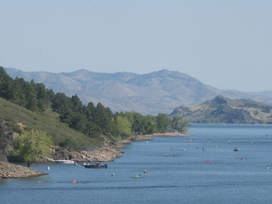 Swimmers in the Horsetooth Open Water Swim make their