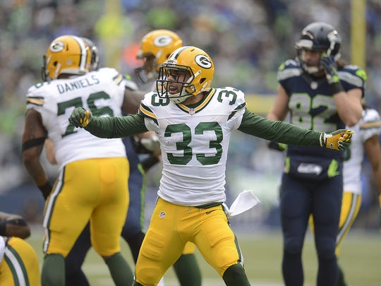 Green Bay Packers defensive back Micah Hyde (33) reacts