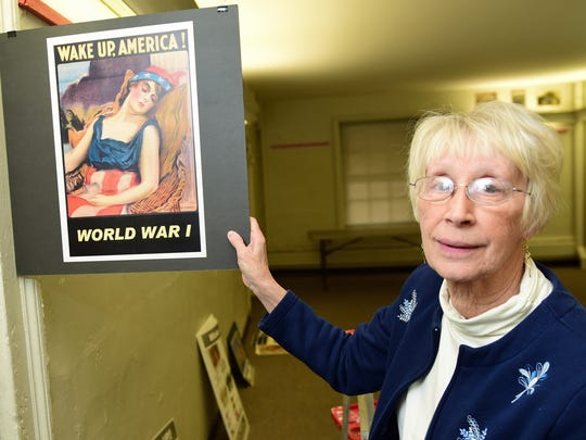 In this photo from April 2016, Franklin County Historical Society Executive Director Ann Hull shows a World War I poster urging America to get involved in the war.