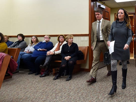 Former Door County Humane Society executive director Carrie Counihan and her lawyer Eric R. Wimberger arrive at Door County Circuit Court for her sentencing hearing Friday, after pleading no contest to five theft charges.