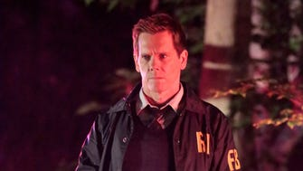 Ryan Hardy (Kevin Bacon) investigates a crime scene in Monday's 'New Blood' season premiere episode of 'The Following.'