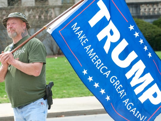 Terry Bush of Lawrenceberg, Ky., hoisted a Trump: Make America Great Again! banner at a pro-Trump rally at the Kentucky State Capital in Frankfort.  Bush, a private citizen, sported his SIG .357. March 25, 2017