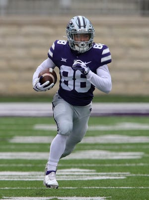 Kansas State sophomore Phillip Brooks (88) returns a punt against Kansas on Saturday at Bill Snyder Family Stadium. Brooks was named Big 12 special teams player of the week after returning two punts for touchdowns in the game.