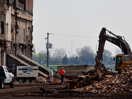 Demolition work is ongoing Wednesday, May 6, 2015 at the former DTE plant in Marysville. Marysville officials are discussing bringing a boutique hotel, marina and restaurants to the site, and renderings are being created to show the potential use of the site.