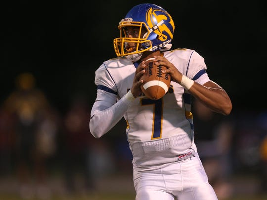 Rickards' D.J. Phillips looks to throw the ball against Madison County during their game on Friday night.