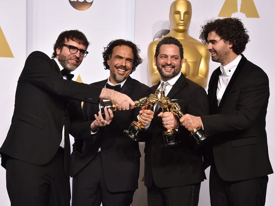 "Nicolas Giacobone, and from left, Alejandro Gonzalez Inarritu, Alexander Dinelaris and Armando Bo pose in the press room with the award for the best picture for ""Birdman"" at the Oscars on Sunday, Feb. 22, 2015, at the Dolby Theatre in Los Angeles. (Photo by Jordan Strauss/Invision/AP)"