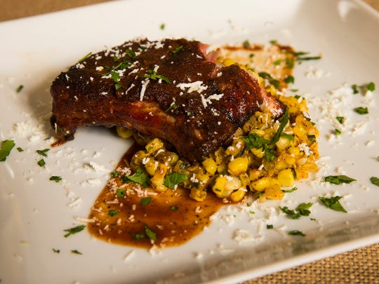 Smoked ribs with smoked Hatch green chile corn salad by Top Home Chef finalist Lynn Hooker, Wednesday, September 28, 2016.