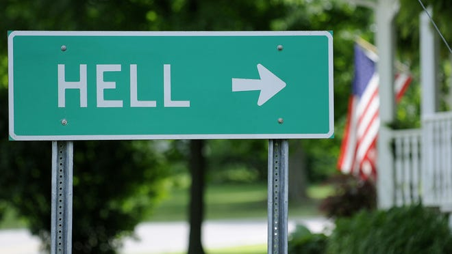 This sign in downtown Gregory, Mich., points the way to Hell.
