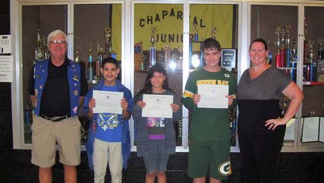 Ned Kline (Kiwanis), Chris Medina, Eva Hoffer, Kaden LoCoco, and Principal Robbi Coker recognize these students as this month's most improved.