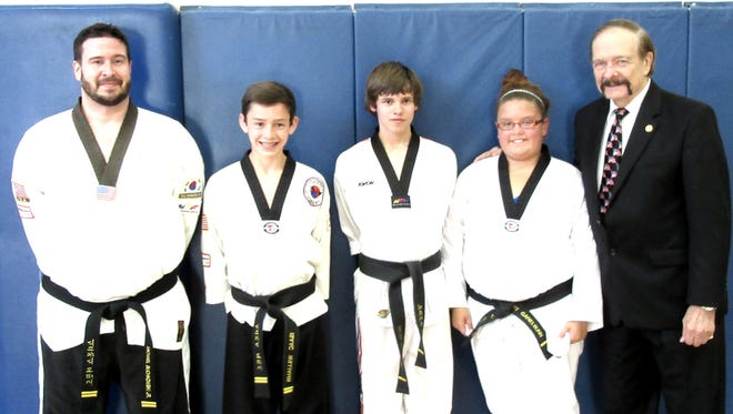 Participants in a recent fall testing at the Stevens Point Area YMCA pose with Dwight Stevens, right. They include, from left to right, Michael Buchkowski, Isaac Williams, Payton Buchkowski, and Mary Gabriel Bunn.