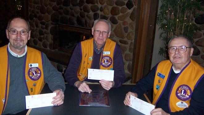 From left, Sturgeon Bay Lions Rose Sale chairmen Greg Virlee, Jim Karwowski and Karl Radosevich anticipate another successful rose sale.