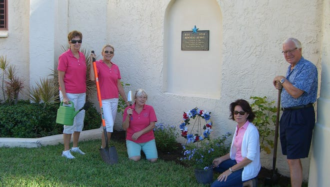 Jensen Beach Garden Club committee members Carol Moschetti, Brenda Hefty, JoAnn Pound, Gail Rounds and Eric Magelssen dig in to prepare for the Blue Star ceremony.