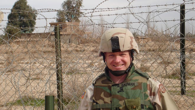 Chris Bauman, recently selected as the next Ozark superintendent, was deployed for nearly a year to Iraq.