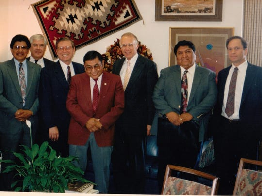 This photo was taken in Senator Pete Domenici's Washington, D.C. office after a Senate Hearing on the Jicarilla Apache Water Rights Settlement agreement (l-r: Jicarilla President Levi Peseta, Lester Taylor, Senator Pete Domenici, former Jicarilla President Hubert Velarde, Al Utton, Jicarilla Council Member Rudy Velarde, and Dan Press.