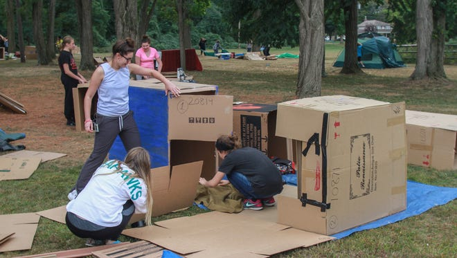 """Tinton FAlls,  NJ    Volunteers set up """"Cardboard Box City"""" at Monmouth Church of Christ in Tinton Falls.  This fundraiser for Family Promise homeless shelter where participants raise at least $100 and sleep overnight in solidarity for the region's homeless.092415"""