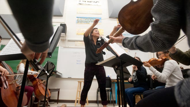 Louisville Youth Orchestra music director and conductor Deanna Tham works with some of the orchestra's young musicians at the Youth Performing Arts School. The orchestra includes over 350 musicians from 60 schools and 15 counties from the Louisville and Southern Indiana metropolitan area.13 November 2016
