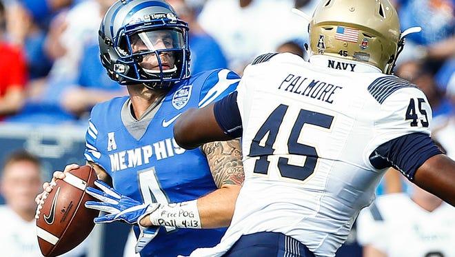 University of Memphis quarterback Riley Ferguson makes a first down pass against the Navy defense during third quarter action Liberty Bowl Memorial Stadium in Memphis, Tenn., Saturday, October 14, 2017.