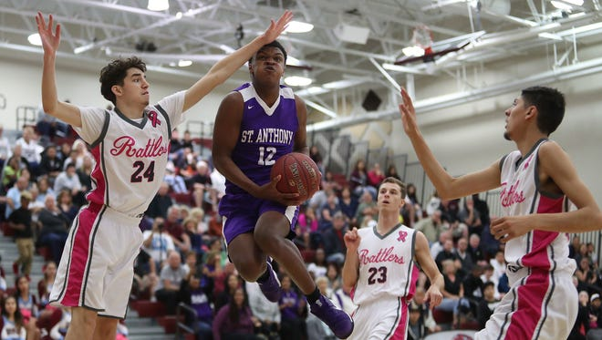 Gorden Boykins of St. Anthony drives between Rancho Mirage defenders, February 16, 2018.