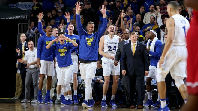 South Dakota State bench celebrates a made three pointer at the 2018 Summit League Basketball tournament at the Denny Sanford Premier Center in Sioux Falls.