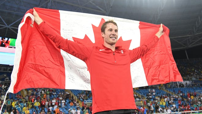Derek Drouin (CAN) wins gold during the men's high jump final in track and field competition in the Rio 2016 Summer Olympic Games at Estadio Olimpico Joao Havelange.