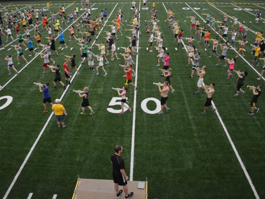 University Iowa drum major Quentin Marquez, bottom, leads rehearsals Wednesday at the Hawkeye Marching Band's new indoor practice facility in Iowa City.