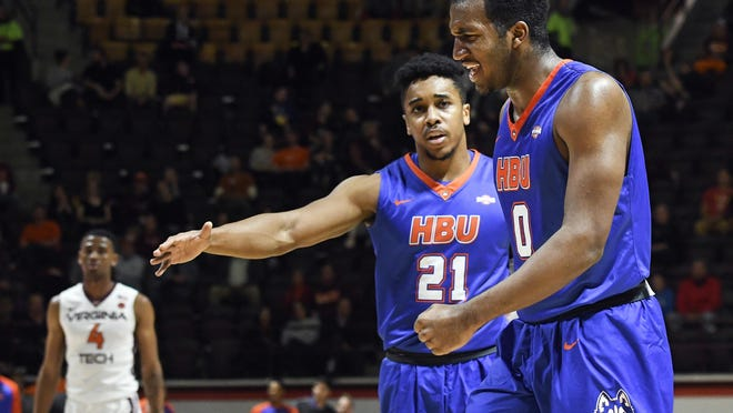 Houston Baptist's Ian DuBose, right, reacts with guard Will Gates Jr., during a game at Virginia Tech earlier this season. HBU has also played high-major competition in Providence and Oklahoma State heading into tonight's game at Michigan State.