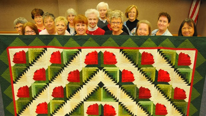 "The Seaside Piecemakers Quilt Guild is getting ready for its ""Quilting a Memory"" show at the Melbourne Auditorium Friday and Saturday March 4 and 5. Members of the guild hold up an Opportunity Quilt that will be raffled at the show to benefit Candlelighters of Brevard."